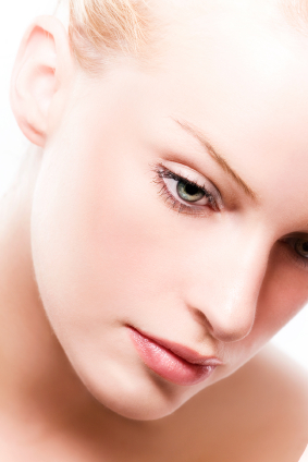 anti aging face cream - woman face close up