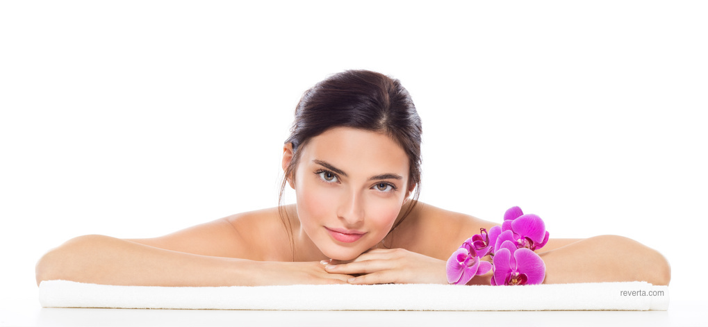 woman in spa on towel with flowers