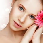 woman with red gerber daisy