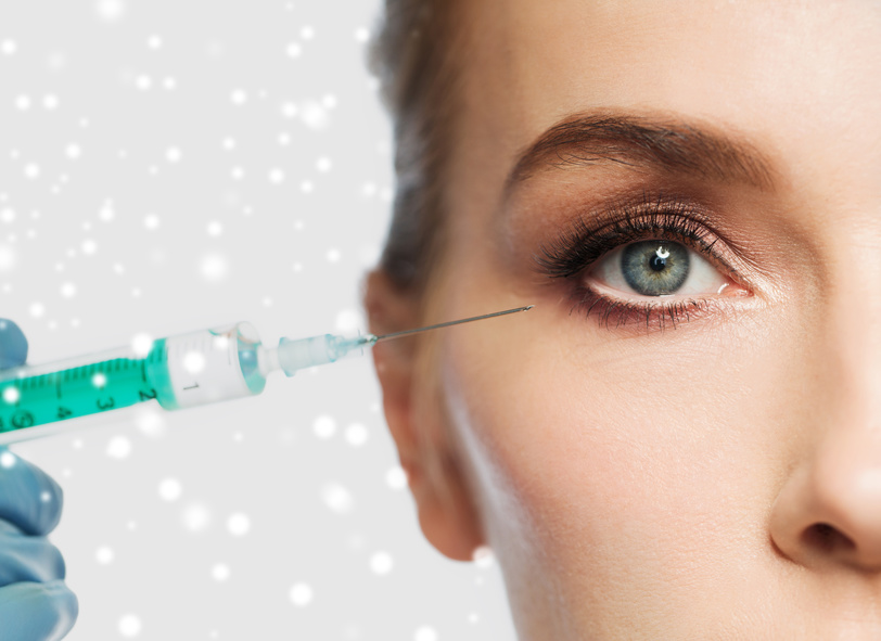 woman's face and syringe